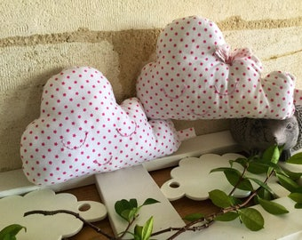 "The duo of cushions clouds cotton ""stars""."