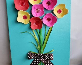 Upcycle - Pink, Yellow and Orange Egg Carton Flowers with Button Center on Turquoise Frame