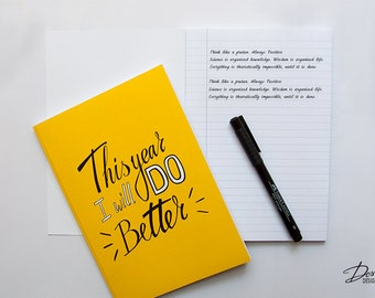 Yellow Typographic Notebook with 100 lined pages
