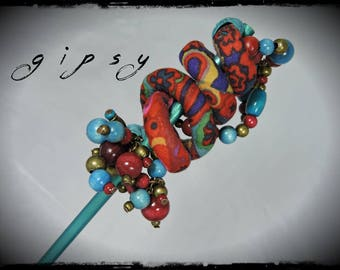 SOLD - Pic has hair Gypsy - multicolored fabric with dominant red, Teal and purple - wooden beads