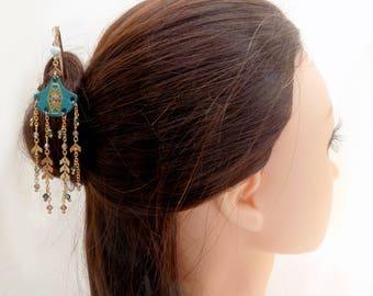 Pic à cheveux doré pendentif cuir éventail turquoise chaîne épi, cristal vert et doré