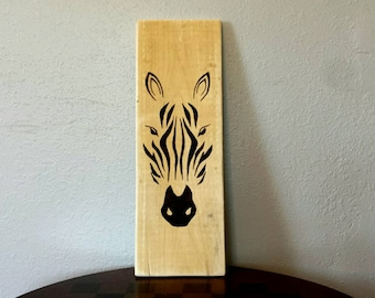 Beautiful hand painted wall decor. African style art of zebra painted with a walnut stain.