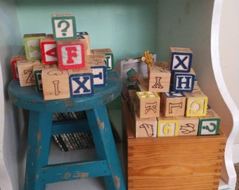 Vintage letter and picture blocks in wooden box