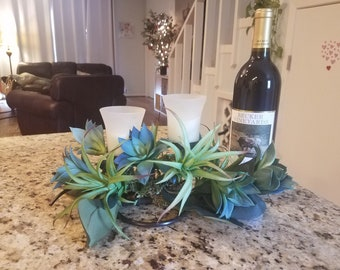 Centerpiece with candles, artificial succulents and air plants