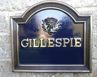 Large house name sign with thistle for scotland motif in cold bronze with an oxford blue background and 16 letters of your choice.