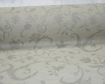Linen / cotton fabric (200 g/m2). Densely woven, cotton blended, brown/sand color fabric with flower ornaments.