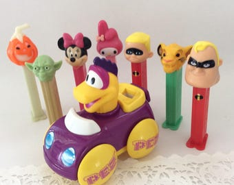 Toy Hall of Fame - Pez - Pez-a-Saurs Car  - Yoda - Star Wars Collectible - Disney Pez - Minnie Mouse - classic Disney - Lion King
