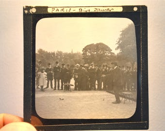 Original antique Edwardian photographic glass slide Bird tamer Paris France circa.1900
