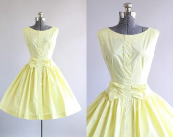 Vintage 1950s Dress / 50s Cotton Dress / Lemon Yellow Dress w/ Decorative Bow and Full Skirt S