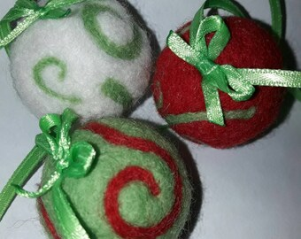 Felting three balls for Christmas.
