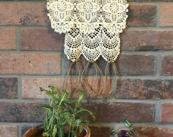 Small rustic lace and tree bark wall hanging