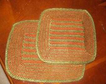 Green and orange crochet set of 2 hotpads.