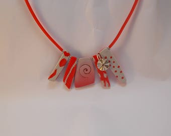Red and gray necklace called polymer clay