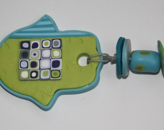 Small Hamsa wall hanging in lime-green and turquoise, with purple-green-white squares, polymer clay, millefiori