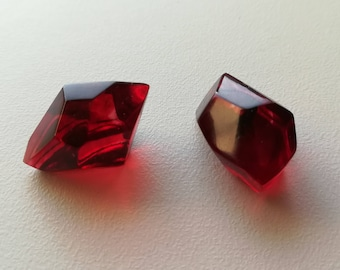 Two unique handmade resin red flame gems