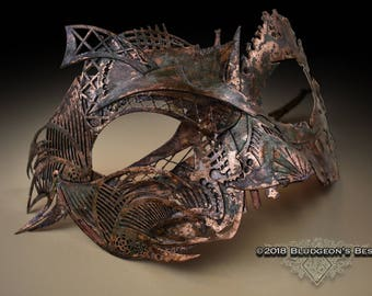 Weathered copper-gilded mask
