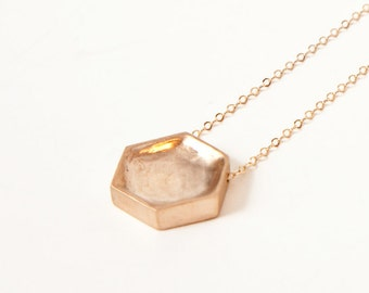 Cast bronze honeycomb pendant