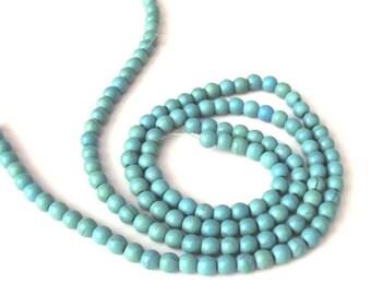 "Turquoise Magnesite Beads 4-5mm Round - 15"" Strand"