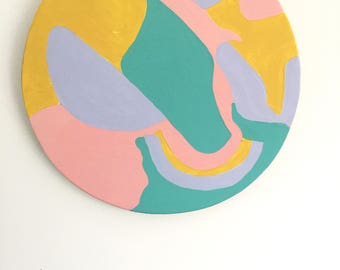 Abstract swirl painted pattern on plywood circle