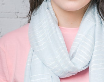 White Striped Long Scarf on a Pale Turquoise Background