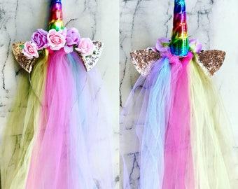 Rainbow Floral Unicorn crown- Hair out.