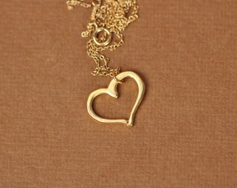 Heart necklace - love necklace - heart outline - gold heart necklace - a 22k gold vermeil heart outline hanging on a 14k gold vermeil chain