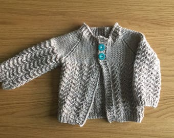 Hand knitted 'ripple' button up cardigan