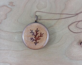 Necklace: bronze-coloured round resin pendant with branch image, on copper chain; gift for her, gift for him