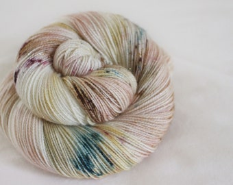 Wrapped Up In Books - Magpie -  75/20/5 superwash merino/ nylon/ gold stellina sock yarn