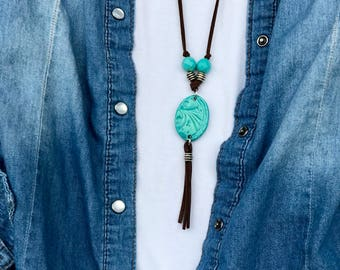 Boho country suede cord tassel necklace can be tied to any length or tied around for double layered look. Handmade turquoise pottery focal
