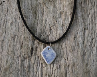 Sea pottery necklace on black faux suede cord
