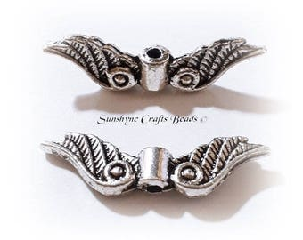 """Antique silver-plated """"pewter"""" (zinc-based alloy), 23x6mm double-sided angel wings. Sold per pkg of 20"""