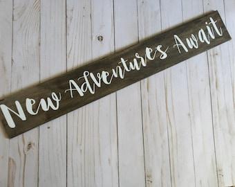New adventures Await wall sign
