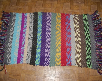 Handwoven accent rag rug made from recycled t-shirts with fringe
