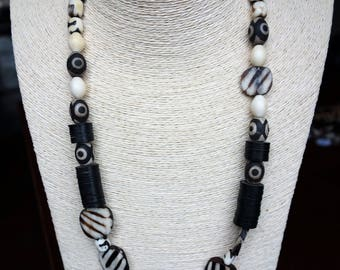 Zebra stripes! Etched bone necklace with vinyl Heishi beads....Out of Africa series.