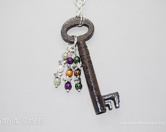 Exploding Stars antique barrel skeleton key decorated with silver star charms, and multi coloured pearl glass beads