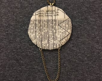 Quilted pendant with chain accent