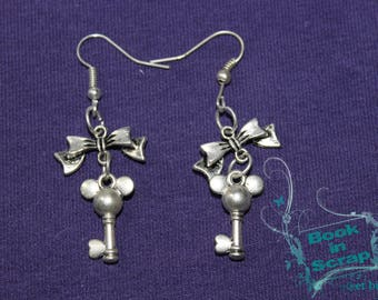 "pair of earring ""mk key"" with bow charm"