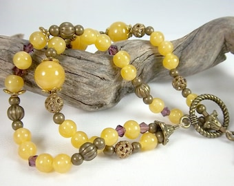 Yellow Bracelet, Vintage Glass Yellow Beads, Purple Swarovski Crystals, Antique Brass Findings, Golden Yellow Bracelet, Two Strand Bracelet