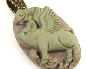 When Pigs Fly Pendant of Carved Ribbon Jasper
