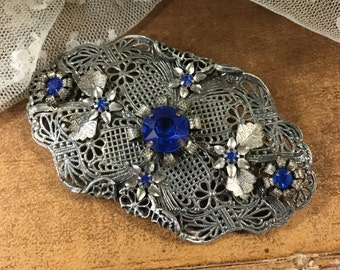 Bold Victorian Revival Sapphire Blue Rhinestone Brooch Pin Silver Tone Filagree Large Prong Set Romantic Oval Garden Trellis Flowers Floral