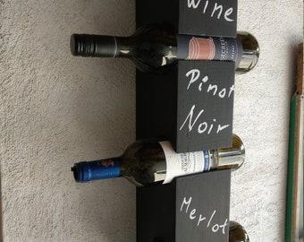 Chalkboard Wall wine rack for four bottles.