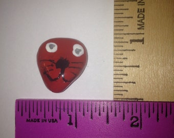 Two-eyed Red Pet Rock Monster? with whiskers