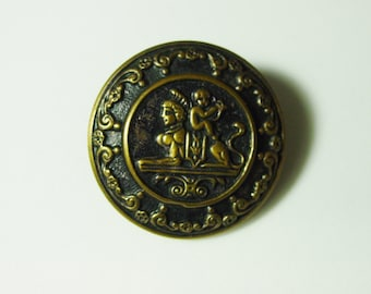 """Nice Large Antique Metal Picture Button, Cherub Sitting on A Sphinx, 1 3/8"""""""