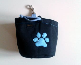 Black dog treat pouch with a colourful bone motif