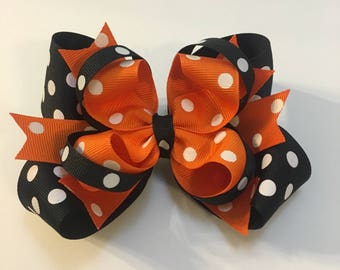 Black and orange polka dot Hairbow