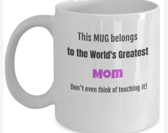 This Mug belongs to the world's greatest Mom.  Don't even think of touching it! white and fuchia 11 oz mug, Mother's Day, gift idea.