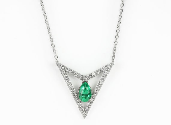 gold pin emerald necklace pendant diamond