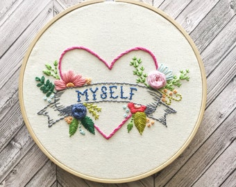 "heart embroidery hoop with ""myself"" banner and flowers"