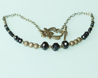 Ras brilliant neck black and bronze necklace